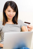 Asian woman using laptop for online shopping Royalty Free Stock Photo