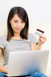 Asian woman using laptop for online shopping Stock Photos