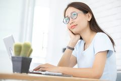 Asian woman using laptop at home, stock photo