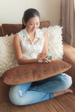 An Asian woman using mobile device Stock Image