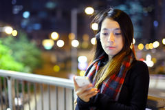 Asian woman using mobile Royalty Free Stock Photography