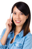 Asian woman using mobile phone Stock Photography