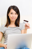 Asian woman using notebook for online shopping Royalty Free Stock Photography