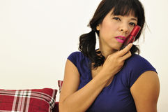 Asian woman using perfume atomizer Royalty Free Stock Images