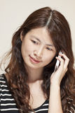 Asian woman using phone Royalty Free Stock Photo