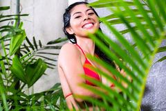 Asian woman using shower in tropical garden Stock Image