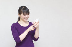 Asian woman using smart phone Stock Photo