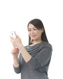 Asian woman using a smart phone Royalty Free Stock Photos