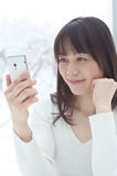 Asian woman using a smart phone Stock Image