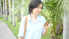 Asian woman using a smart phone, stock footage