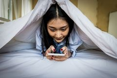 Asian woman using a smart phone royalty free stock photos