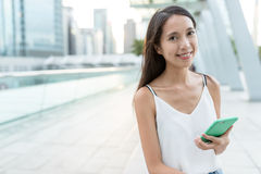 Asian woman using smart phone at outdoor. Asian young woman Royalty Free Stock Photo
