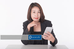 Asian woman using smart phone with search engine graphic Stock Image