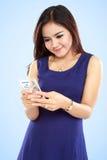 Asian woman using smartphone Stock Image
