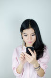 Asian woman using smartphone Stock Photography