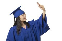 Asian woman using a smartphone to take a salfie of herself weari Stock Photos