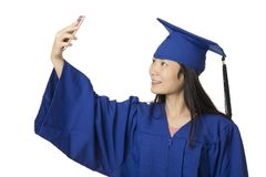 Asian woman using a smartphone to take a salfie of herself weari Stock Photo