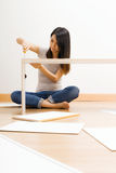 Asian woman using strew drive for assembling closet Stock Images