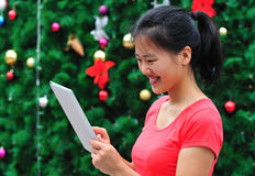 Asian woman using tablet  Royalty Free Stock Photos