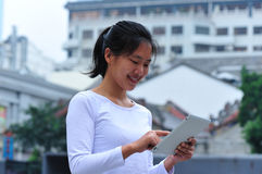 Asian woman using tablet Stock Photography