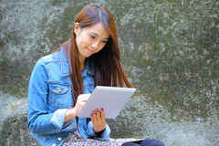 Asian woman using tablet computer Royalty Free Stock Photo