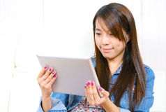 Asian woman using tablet computer Stock Photos
