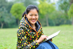 Asian woman using tablet computer Royalty Free Stock Photography