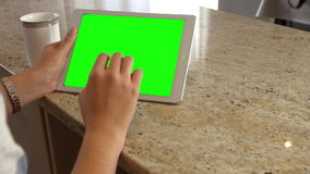 Asian woman using tablet with green screen stock video footage