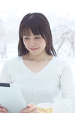 Asian woman using Tablet PC Stock Photography