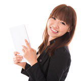 Asian woman using a tablet pc. Portrait of happy Asian woman using a tablet pc isolated on white background. Asian female model Stock Photography