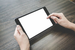 Asian woman using tablet pc on a wood table Royalty Free Stock Image