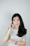 Asian woman using telephone Stock Photos