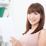 Asian woman using touch screen tablet Royalty Free Stock Photography