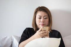 Asian woman utilization cell phone portrait. Stock Photos