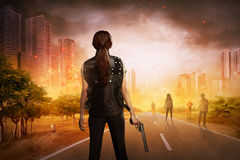 Asian woman with vest and gun. Asian women with vest and gun want to punish the zombies stock photography