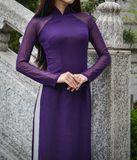 A woman in Vietnamese traditional dress. An Asian woman in Vietnamese traditional dress called Ao Dai at Chinese pagoda Royalty Free Stock Photography