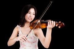 Asian woman and violin Royalty Free Stock Image