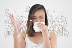 Asian women are vomiting because of morning sickness. Asian woman are vomiting because of morning sickness. Nausea or Vomiting. Have a headache against gray royalty free stock image
