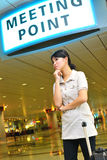 Asian woman waiting at airport Royalty Free Stock Images