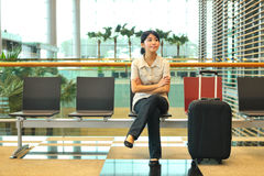 Asian woman waiting at airport Stock Photography