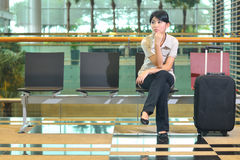 Asian woman waiting at airport. Beautiful asian woman waiting at airport Royalty Free Stock Photography