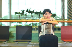 Asian woman waiting at airport Stock Photos