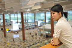 Asian woman waiting at airport Stock Image
