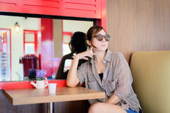 Asian woman waiting in a coffee shop Stock Photography