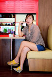 Asian woman waiting in a coffee shop Stock Photo
