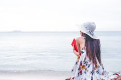 Asian woman waiting for love or someone make her happy. Lonely a. Nd Beauty concept. Back view scene of girl. Ocean and sea theme. Copy space in left side. Woman Stock Photography