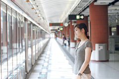 Asian woman waiting for train Royalty Free Stock Image