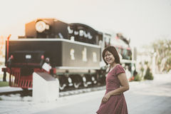 Asian woman waiting for train coming for travel transportation vintage style Royalty Free Stock Photos