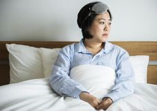 An asian woman waking up Royalty Free Stock Images