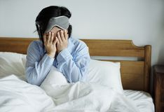 An asian woman waking up Stock Photo
